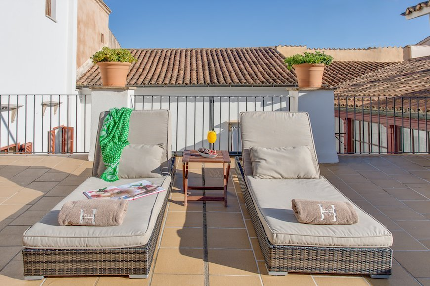 Relax on the roof terrace at Boutique Hotel Can Cera with MallorcanTonic