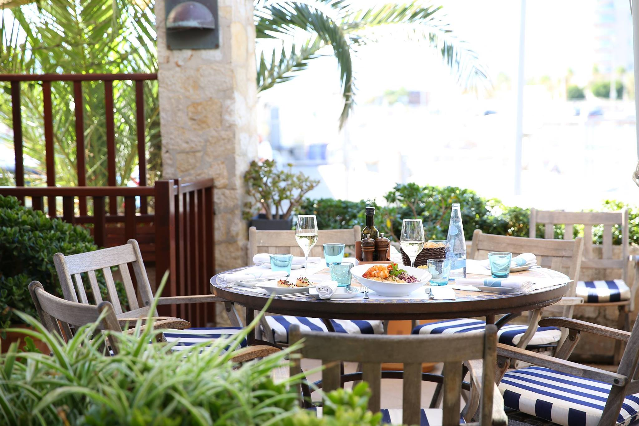 Sit and have lunch on the terrace at Portixol Hotel Palma