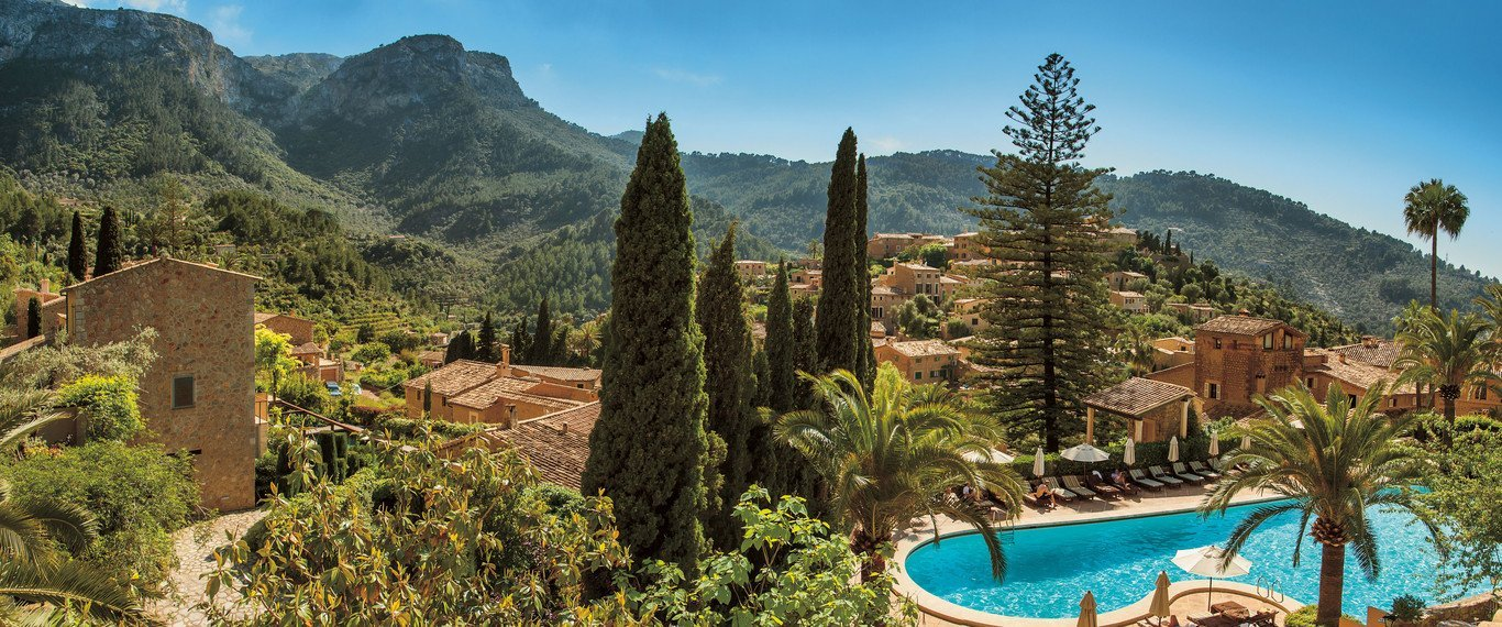 Swim in the heated outdoor pool - what a view at Belmond La Residencia - Mallorca - Guide to Majorca